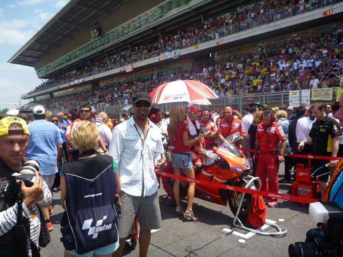 Rich_on_the_grid_next_to_Casey_Stoner_at_MotoGP_Catalunya.jpg